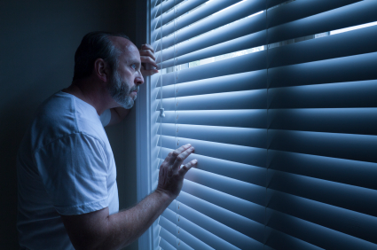 Homeowner Nervously Checks On Outside Noise Late At Night